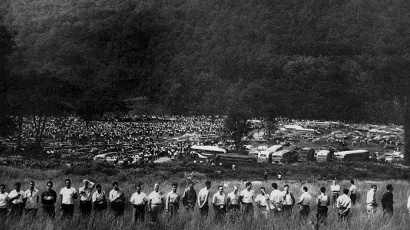 A section of the defense line and a portion of the sudience gathered for the second Peekskill concert. Remember that this defense line stretched all around the concert grounds and held its position in the hot sun for many hours. It was on the ridge in the background that two snipers were concealed.