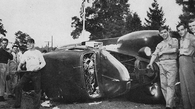 A smashed car of some concert-goers and the hoodlums who did the smashing. These are obviously too young to have been veterans and were probably recruited for the occasion by neighborhood fascist organizations.
